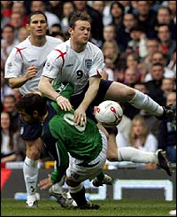 Wayne Rooney goes down under a challenge