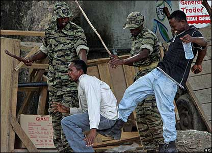 Soldiers beating a suspected opposition supporter