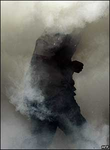 Man engulfed in teargas