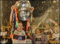 Ospreys skipper Barry Williams hoists the Celtic League trophy in celebration