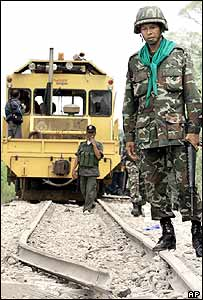 A Thai soldier examines the rail track where two bombs exploded in Narathiwat province, southern Thailand