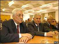 Palestinian leader Mahmoud Abbas (L) attends a meeting of Fatah's Revolutionary Council in Gaza City