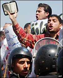 Riot police confront Muslim Brotherhood demonstrators in Cairo