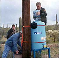 Humane Borders volunteers set up a water station in the desert