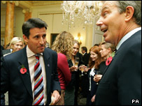 Prime Minister Tony Blair and Lord Sebastian Coe at a party to celebrate the bid's success.