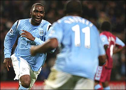 Andrew Cole and Darius Vassell celebrate City's third goal