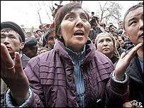 A Kyrgyz opposition supporter argues in Bishkek