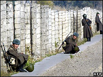 Kyrgyz soldiers guard an area outside the Moldovanovka penal colony, some 37 km outside Bishkek, 01 November 2005.
