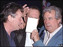 Pythons Michael Palin and Terry Jones try to obscure Terry Gilliam