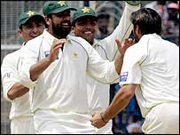 Pakistan's players celebrate the dismissal of VVS Laxman