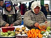 Vendors sell vegetables at a city market in Bishkek