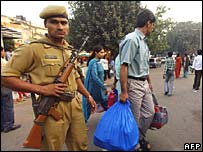 Policeman on guard at Sarojini Nagar market, Delhi, scene of one of the blasts