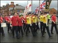 Parade passes Ardoyne shops