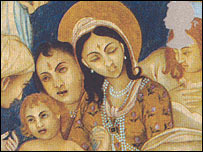 The Hindu pair are shown worshipping the baby Jesus