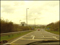 View of the M74 through a driver's windscreen