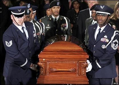 An honour guard carries the casket of Rosa Parks into the Rotunda of the US Capitol
