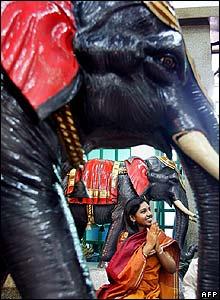 A Malaysian Hindu faithful prays at a temple in Kuala Lumpur, Malaysia