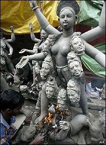 A man works on an idol of Hindu goddess Kali at Kumartuli in Calcutta, India