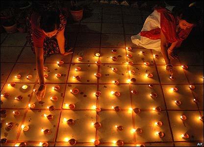 Women light earthen lamps, in Agartala, India