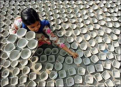 A girl dries clay diyas in Amritsar, India