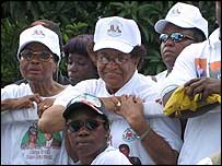 Ellen Johnson-Sirleaf, surrounded by officials