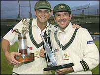Ricky Ponting (r) and man of the series Adam Gilchrist celebrate their triumph in New Zealand
