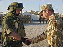Romanian President Traian Basescu (right) meets Romanian troops in Iraq, 28 Mar 05