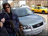 Kevin Bacon tries out the hybrid Ford Escape