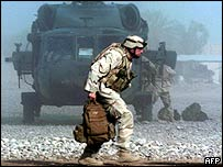 US soldier exits helicopter