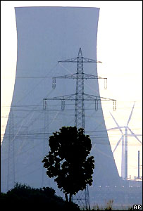 Wind turbine behind cooling tower of coal-fired power station.  Image: AP/Soeren Stache