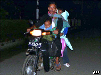 People try to leave the city of Banda Aceh, Sumatra, for higher ground