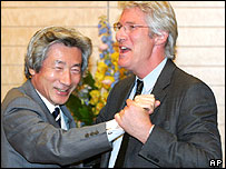 American film star Richard Gere, right, and Japanese Prime Minister Junichiro Koizumi laugh as they dance together at the prime minister's official residence in Tokyo Tuesday, March 29, 2005