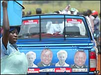 Woman in front of an opposition vehicle in Zimbabwe