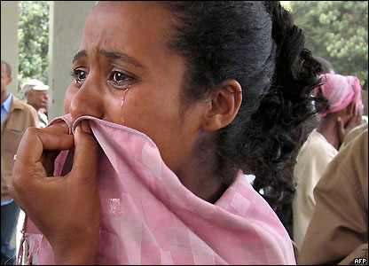 Woman cries as wounded rushed into an Addis Ababa hospital