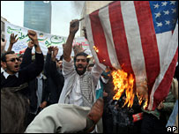 Iranians burn a US flag during a demonstration in front of the former US Embassy