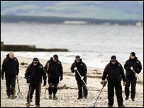 Police comb a beach in Scotland