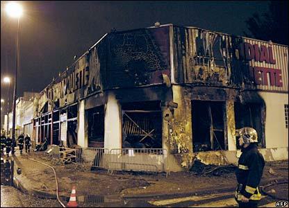 A burned-out shop front in Bondy, Paris