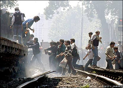 People carrying stolen goods cross the tracks at Haedo station
