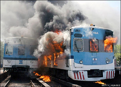 Two train carriages set ablaze by angry commuters