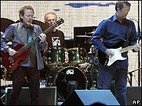 Cream - bassist Jack Bruce (l), drummer Ginger Baker, and guitarist Eric Clapton (r)
