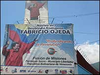 Banner at the entrance to the Fabricio Ojeda cooperative centre in a shanty town in Caracas
