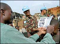UN troops hand out leaflets in Bunia about the disarmament deadline