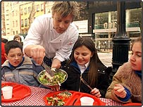 Celebrity Chef Jamie Oliver serves up a healthy school dinner to pupils from Ealdham Primary School, Greenwich, in Leicester Square, London