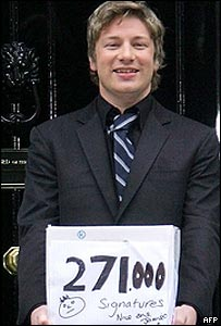 Jamie Oliver delivering his petition to Tony Blair