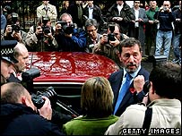 David Blunkett leaves the Foreign Press Association after making a statement