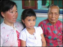 left to right, Nguyen Thi Thanh, her daughter and her mother-in-law