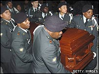 A military honour guard accompanies Rosa Parks' coffin to her funeral in Detroit