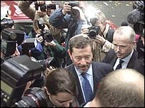 David Blunkett arriving at his press conference in central London