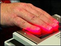 Charles Clarke using fingerprint reader