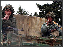 Syrian soldiers give the thumbs up as they leave Lebanon